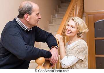 Mature couple near staircase