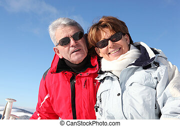 Mature couple on a skiing holiday