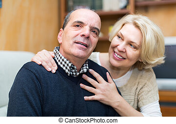 Mature couple on couch at home