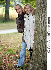 Mature couple out for an autumn stroll