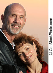 Mature couple outdoors, close-up