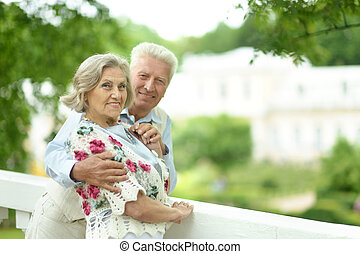 Mature couple outdoors - Portrait of cute smiling mature...