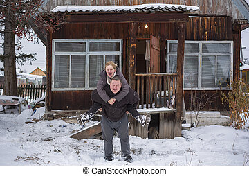 Mature couple outside in snowy landscape