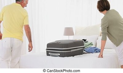Mature couple packing