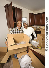 Mature couple packing.