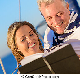 Mature Couple Reading Book