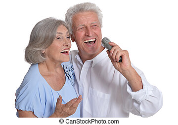 mature couple singing songs, against white background