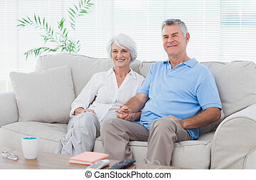 Mature couple sitting on a couch