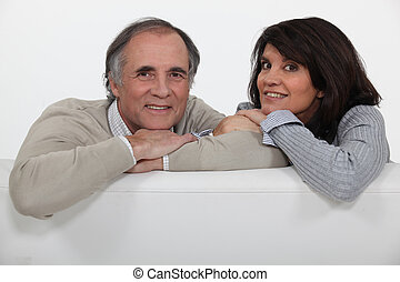 mature couple sitting on the couch
