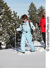 Mature couple snowshoeing