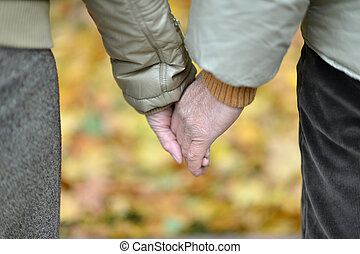 couple spending time outdoor in the park - Mature couple...