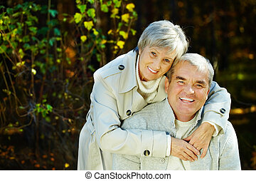Mature couple - Photo of amorous aged man and woman looking...