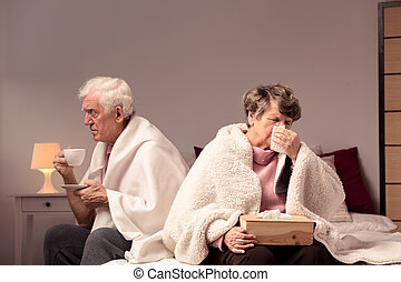 Mature couple suffering from a flu