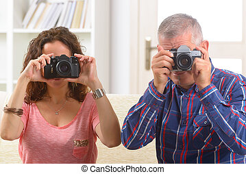 Mature couple taking pictures