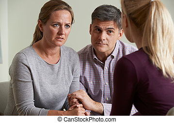 Mature Couple Talking With Counsellor
