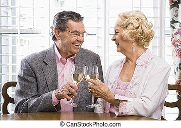 Mature couple toasting.
