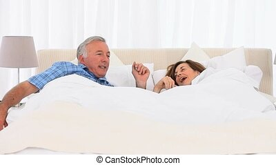 Mature couple waking up
