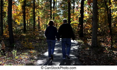 Mature Couple Walk Path