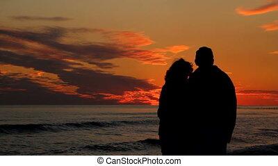 Mature Couple Watching Sunset