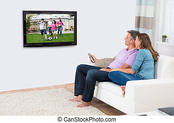 Mature Couple Watching Television At Home