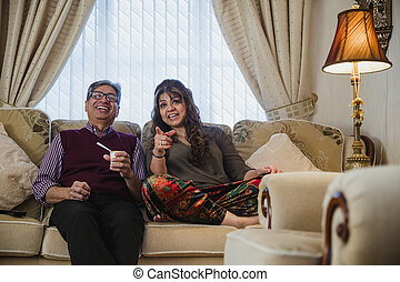 Mature Couple Watching TV Comedy