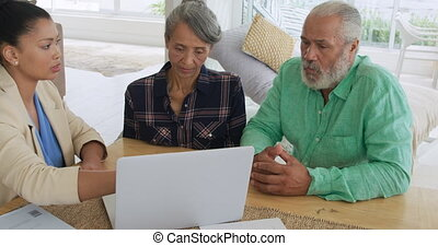 Mature couple with advisor at home