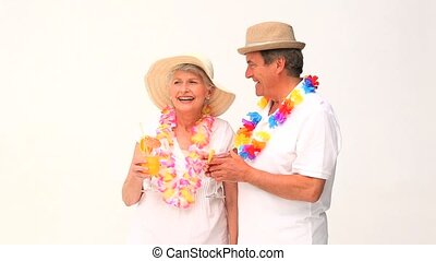Mature couple with cocktails in vacacion