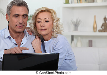 Mature couple with computer