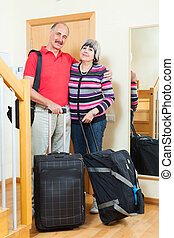 mature couple with luggage going on holiday - mature couple...