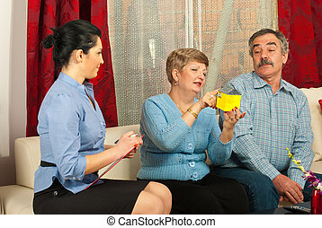 Mature couple with real estate agent