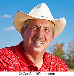 Mature Cowboy - Portrait of a handsome, mature cowboy ...