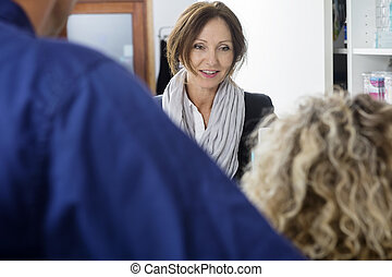 Mature Customer Looking At Dentist In Clinic