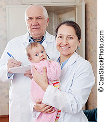 doctor and nurse with baby
