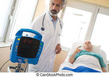 mature doctor examining a senior patient