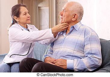mature doctor examining senior  patient