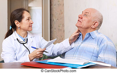mature doctor touching neck of man