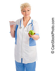 Mature doctor with apple and pills