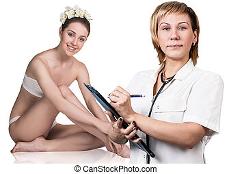 Mature doctor woman takes notes in card and patient sitting.