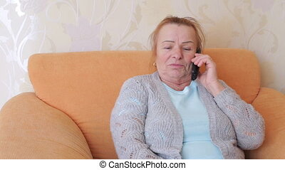 Mature emotional woman talking on the phone