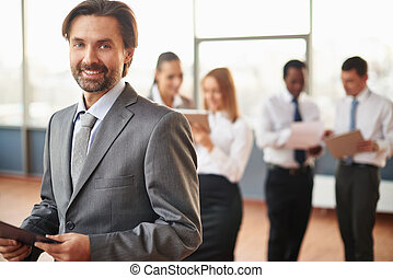 Mature employer - Mature businessman in suit looking at...