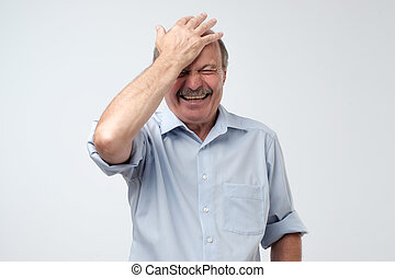 Mature european man laughing on funny joke