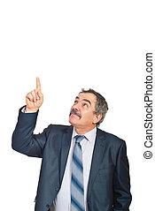 Mature executive pointing upwards to copy