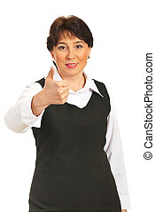 Mature executive woman giving thumbs