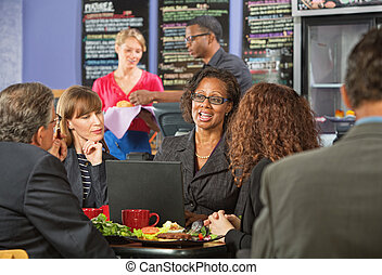 Mature Executives and Working Lunch - Attractive white...