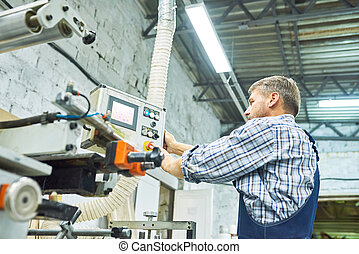 Mature Factory Workers Operating  Machines