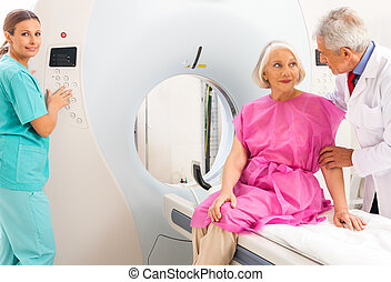 Mature female patient in 60s instructed by doctors about mri...