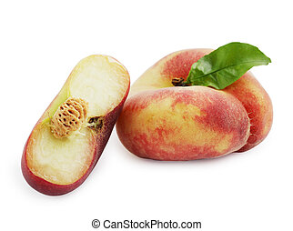 Mature flat peaches isolated