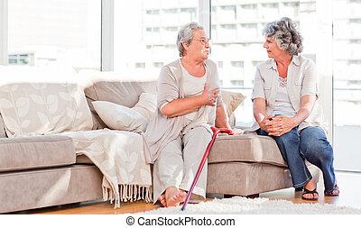 Mature friends talking on the sofa