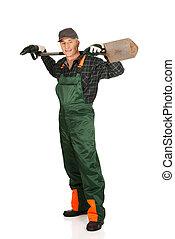 Mature gardener holding a spade