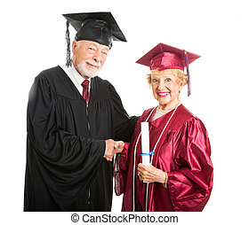 Mature Graduate Receives Diploma